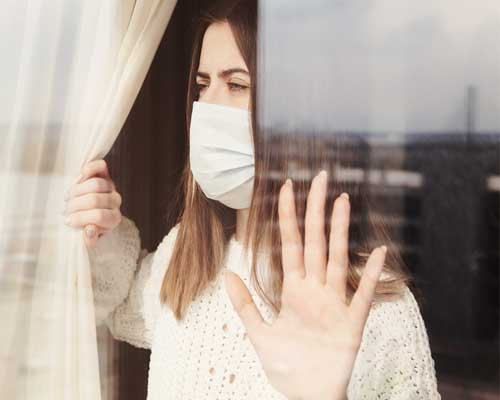 woman-in-quarantine-looks-out-window